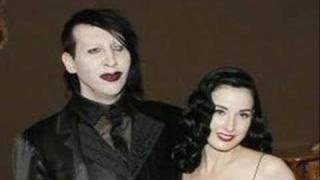 Watch Marilyn Manson A Rose And A Baby Ruth video
