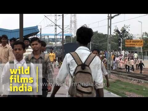 Indian school kids with British school ties + crowded train commuters disembark