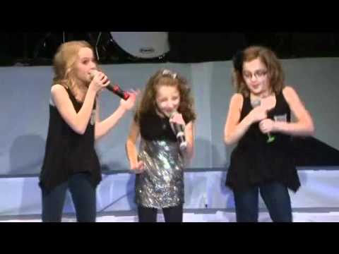 "Avery and The Calico Hearts (Avery Winter, 9, Brooklyn Elbert, 10, and Kassidy King, 10) perform ""Santa Claus is Coming to Town"" at the Cactus Kids Christmas..."