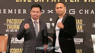MANNY PACQUIAO SIZES UP KEITH THURMAN DURING FACE TO FACE IN LOS ANGELES