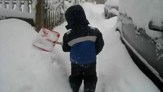 Boy shovels during Blizzard of
