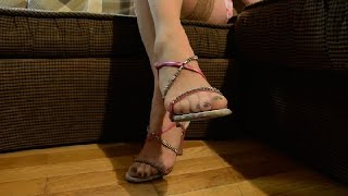 Nude stockings legs in pink High Heel Sandals.