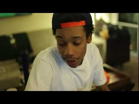 Wiz Khalifa records new song for Dj Drama. Smokes alot of weed.