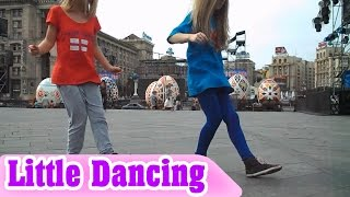 Two Young Girls Dancing on Shopping Plaza