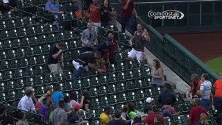 Houston Astros fan gets tangled up going for a foul ball June 17 2013