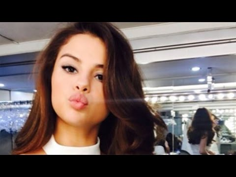 Selena Gomez Puckers Up in a White Halter Dress Selfie Rocks Two-Toned Jeans at LAX thumbnail