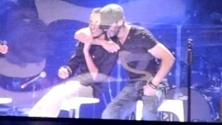 Enrique Iglesias with a gay fan on stage
