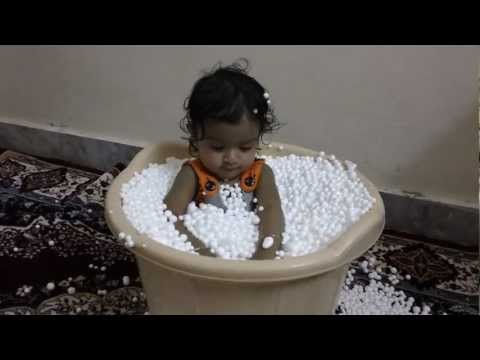 Varshita Playing with Thermocol Balls