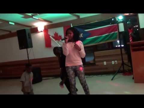 Awach Santino Bol sang Micheal Jackson song during Aweil Youth Christmas party in Calgary