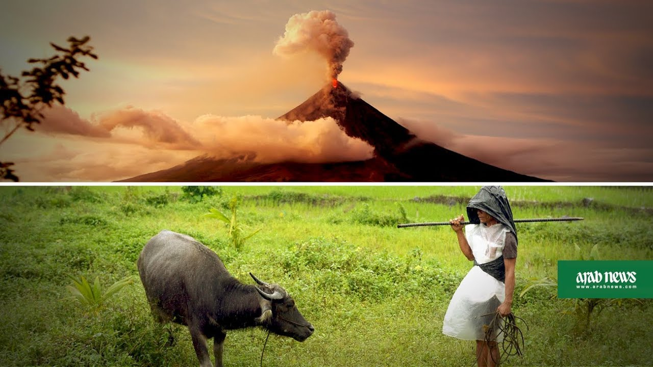 Fearless Philippine farmers defy volcano anger