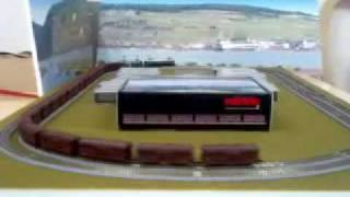 Maerklin Miniclub E50 and E40 run with 20 coal hopper cars.