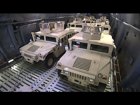 Poroshenko gets military Humvees from US, takes a spin