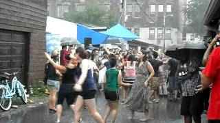 Dancing in the rain at Ossington Village Alleyway Party