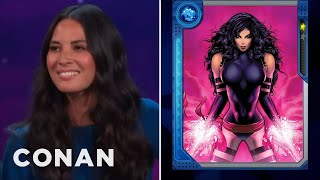 "How Olivia Munn Squeezes Into Her ""X-Men"" Costume  - CONAN on TBS"