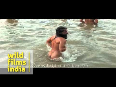 Naga sadhus have a holy bath at Ardh Kumbh Mela