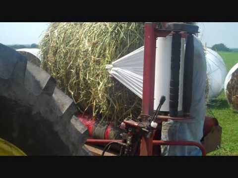 Amateur video - wrapping oats for silage.