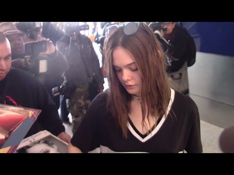 Elle Fanning Wears A Shirt-Dress Through LAX