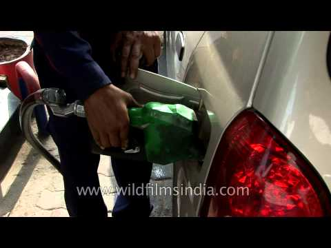 Filling a car with petrol in New Delhi