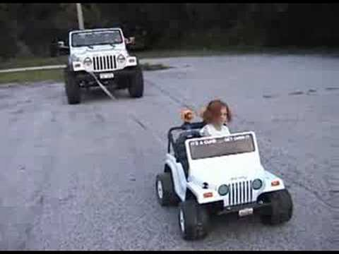 Extreme Power Wheels Jeep pulling real Jeep 4x4!
