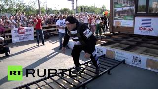Russian strongman sets new world record pulling two-story house