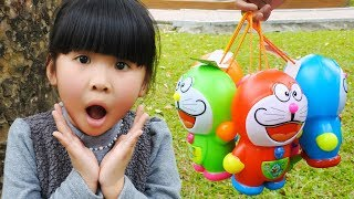 Learn Colors with Funny Kid! Surprise Eggs Candy Doraemon Finger Family Song Nursery Rhymes