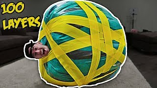UNBREAKABLE GIANT HUMAN RUBBER BAND BALL EXPERIMENT!! (100+ LAYERS)