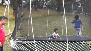Ayush playing on a trampoline with Maanya