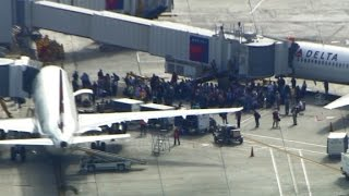 Witness: Airport looked like a war zone