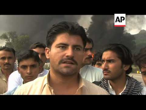 WRAP NATO trucks set on fire in Khairabad, day shots