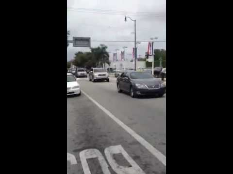 Funeral Procession for Auxiliary Bishop Agustin Roman passing Brickell Honda