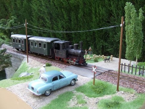 Model train layout narrow gauge 0e 1:43 with old Magic train of Fleischmann