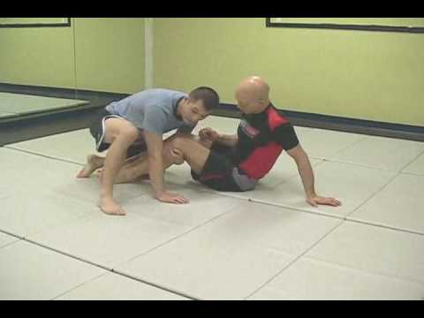BJJ in Vancouver: Butterfly Guard- Punch Pass by Vancouver BJJ coach Image 1