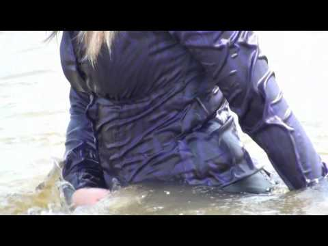 Femke in pantyhose, skirt and satin blouse all wet