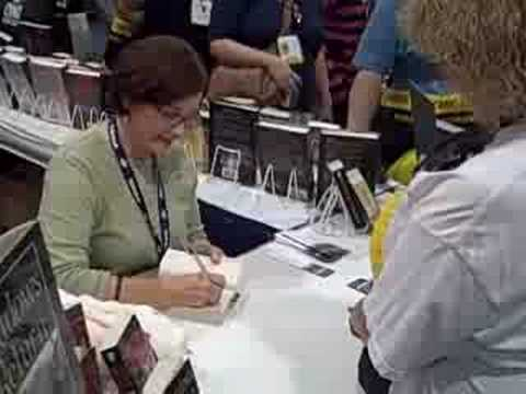 Lynn Flewelling signing copies of Shadows Return at ComicCon