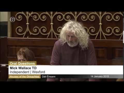 Mick Wallace discussing the ongoing situation in Afghanistan with Minister for Defence Coveney.