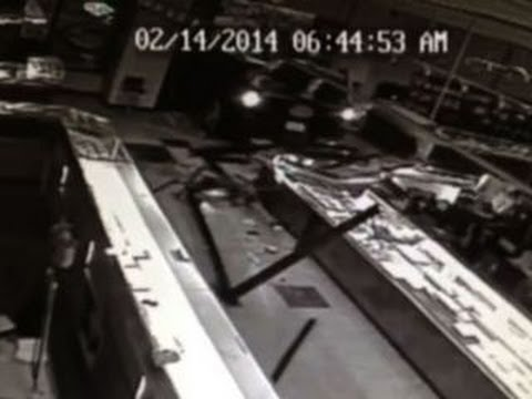 Surveillance video shows thieves smashing into store