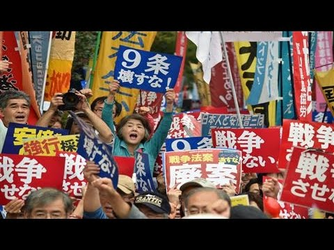 Japan Passes Abe's Security Bills Amid Protests