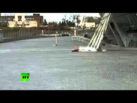 Miracle Escape - Shelled Donetsk stadium wall barely misses girl