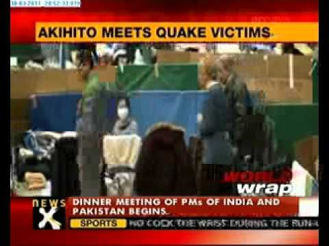 Japan's Emperor Akihito meets quake victims