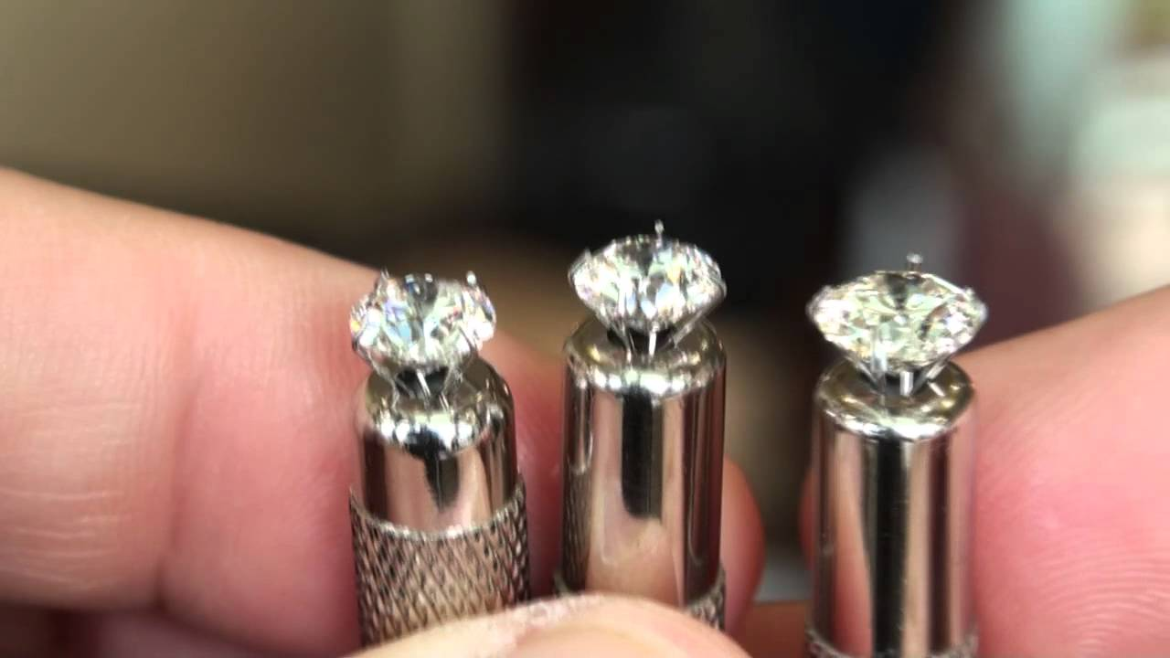 comparing diamond color in natural daylight