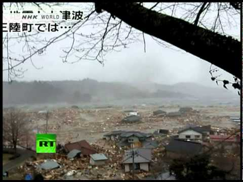 Video of muddy mess as tsunami waves swallow homes, villages in Japan