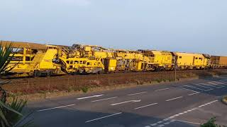 Trains. Freightliner Class 66 locos top and tail a track maintenance train through Starcross.