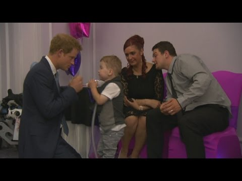 Prince Harry gets hug from young fan