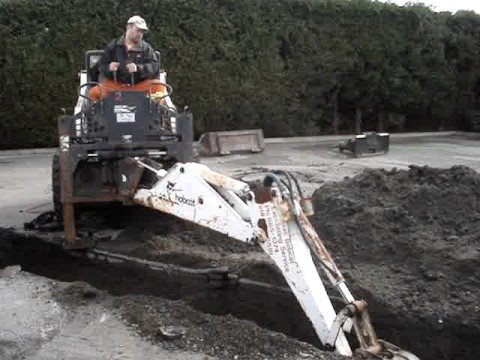 More Digging with a Bobcat 709 Backhoe