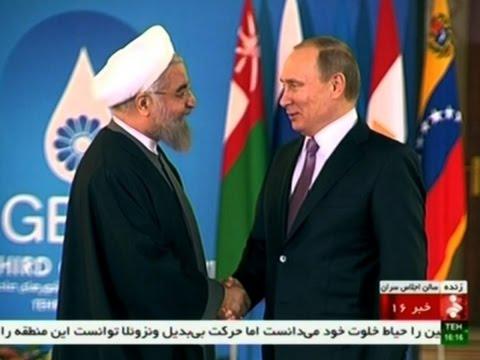Raw: Putin meets Iran's President in Tehran