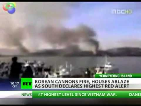 War  South & North Korea fire artillery shells  houses ablaze