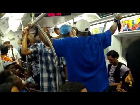 SUBWAY FIGHTS Man and women yelling at each other on crowded 4 train - subway fight