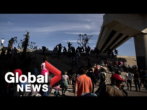 Migrant caravan reaches bridge near US border