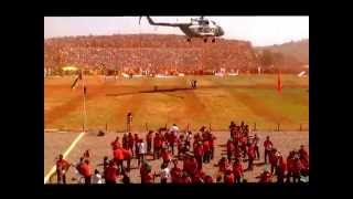 "Military helicopter feeds dust to ruling party members at ""Nationalities Day"" celebration in Asosa,"