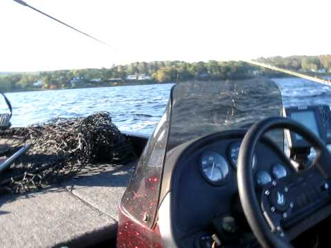 Changing bait while fishing Muskie on the St.John River in Fredericton